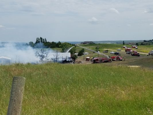Fire crews knock down a fire that destroyed a rural Fort Pierre area barn.