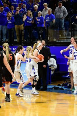 Dru Gylten is greeted by her teammates after being able to play the final seconds of the state championship after suffering a knee injury. Gylten was named to the Class A All State First Team this week.