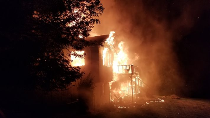 Fire engulfs a home on Conifer Drive early Friday morning.
