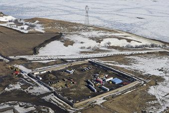 This Feb. 13, 2017, aerial file photo shows a site where the final phase of the Dakota Access Pipeline where it crosses beneath the Missouri River in North Dakota, just north of the Standing Rock Reservation in Emmons County in Cannon Ball, N.D. A federal