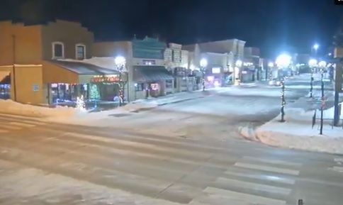 Snow lines the streets in downtown Sturgis Sunday night as the city dug out from Saturday's blizzard.