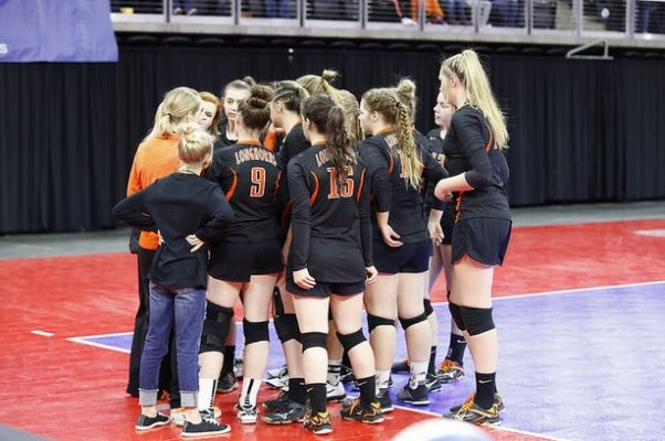 The Faith Longhorn Volleyball Team talks things over during their match with Northwestern Friday night.