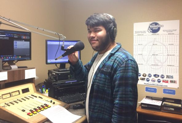 Gabriel Zerbst, a senior at Sturgis Brown High, learns more about real-time radio in one of the production rooms at the Big 81.
