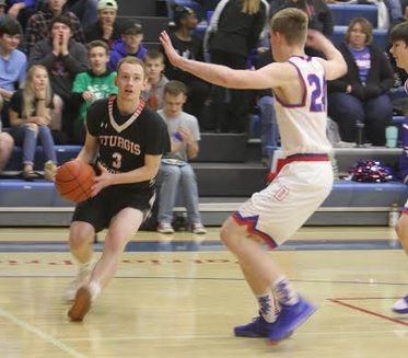 Ryan Garland makes a move around a Douglas defender Friday night in Box Elder.