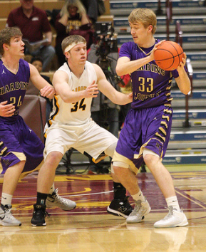 Harding County's Trig Olson plays keepaway from the Warbirds Thursday Night in Class B Basketball Tournament action.