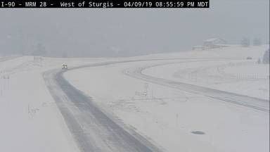 Heavy, wet snow is affecting travel on I-90 in western South Dakota Wednesday.