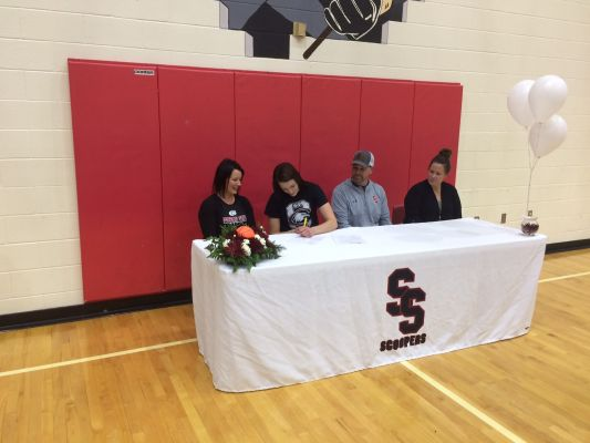 Sturgis Scooper Olivia Jolley signs her letter of intent to play basketball at Chadron State next year. Jolley is joined by her parents and head coach Jordan Profrock.