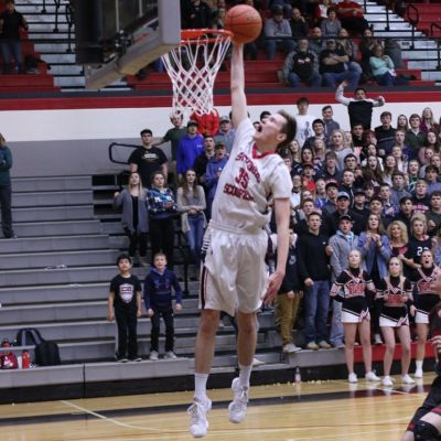 Connor Crane soars to dunk the basketball Monday night.