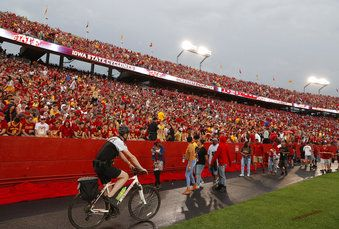 Security tells fans to leave the stadim as lightning nears the Iowa State game Saturday.