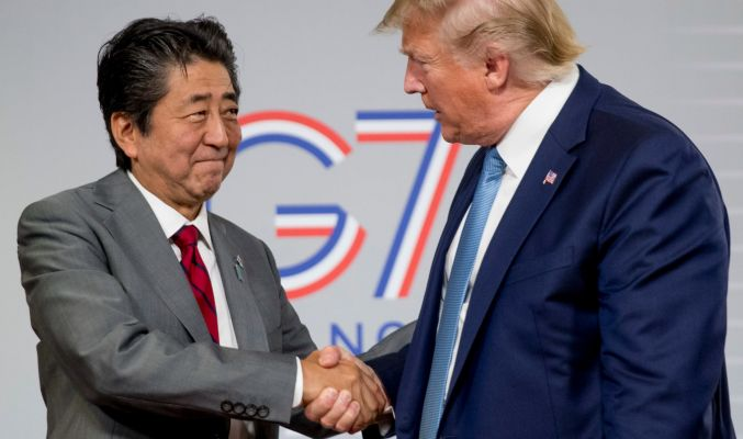 U.S President Donald Trump, right, and Japanese Prime Minister Shinzo Abe shake hands following a news conference at the Group of Seven summit in France over the weekend.