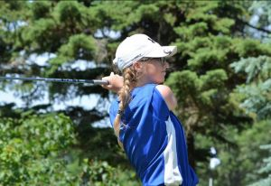 St Thomas More's Alex Kandolin watches her shot at the Girls Class A Golf Tournament.