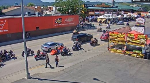 Traffic moves along Lazelle Street Friday as the motorcycle rally heads into its final weekend.