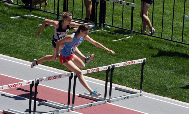 Sturgis and Lincoln battle Saturday in girls 300 meter hurdles.