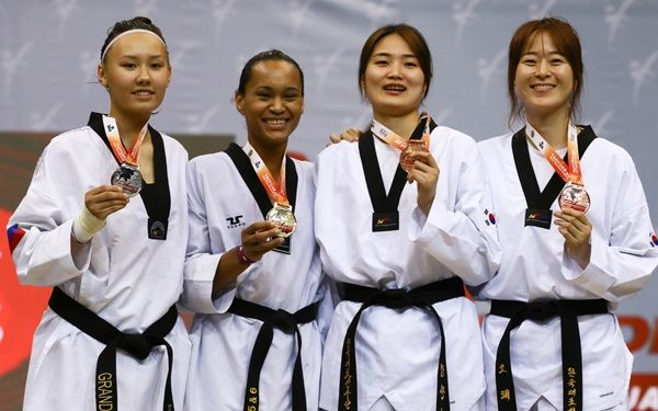 Paige McPherson, second from left, shows off her gold medal.