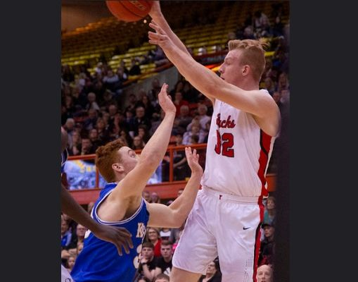 Matthew Mors (32), playing in this year's state tournament, leads the Class AA Boys Basketball All State Team.