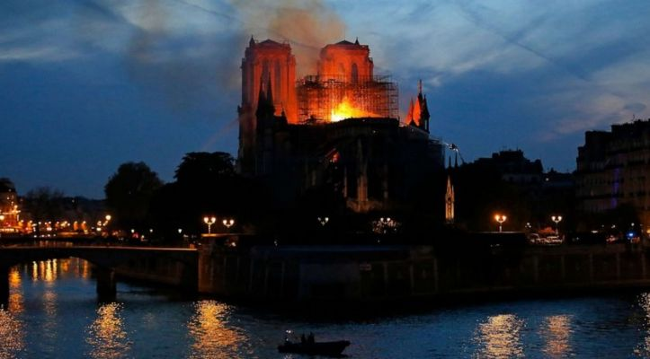 Firefighters tackle the blaze as flames rise from Notre Dame cathedral as it burns in Paris, April 15, 2019.