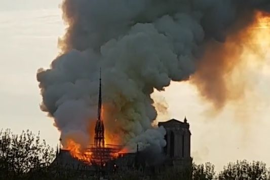 Flames shoot from the roof of the Notre Dame Cathedral after it caught fire