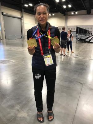 Paige McPherson shows off her medals won at the Pan Am Games.