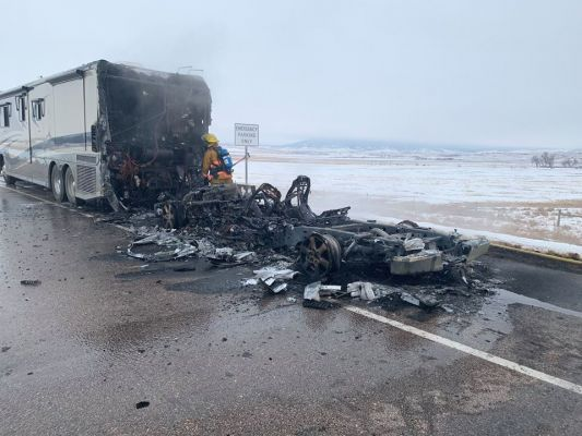 A pickup truck being towed by an RV was destroyed by fire Thursday afternoon.