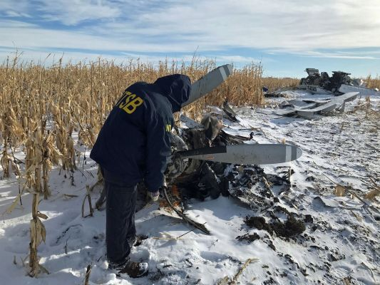Federal and State investigators are now at the scene of a plane crash near Chamberlain that killed nine people and injured three.  The wreckage is in a snow-covered cornfield less than a mile from the Chamberlain Municipal Airport.