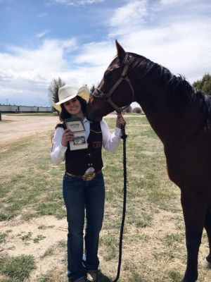 "Rachael Calvo, a University of Wyoming sophomore from Bassett, NE, rode her 13-year-old sale barn horse ""Stella"" to a Central Rocky Mountain Region barrel racing title and a Central Rocky Mountain Region team title."