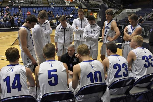 St Thomas More David Hollenbeck goes a play with his team. STM rebounded with a win Friday over Madison.