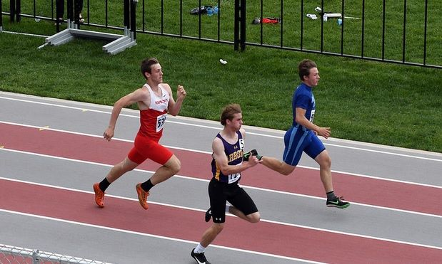 Runners on the track at State AA track and field Friday in Sturgis.