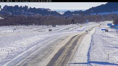 I-90 has reopened, but work remains to clear them, as you can see in this Sunday morning view of I-90 east of Sturgis.