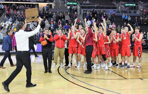 Yankton celebrates winning the Class AA Boys Basketball Championship.