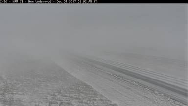 Visibility is poor on portions of I-90, as seen in this SDDOT web camera at New Underwood.