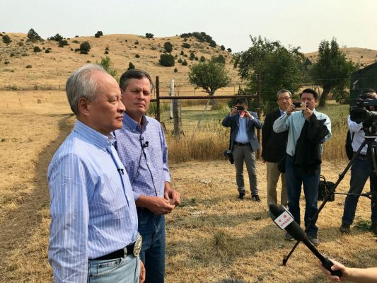 Chinese Ambassador Chui Tian Kai (left) and Senator Steve Daines (MT-R.) speak to the press after a meeting at a ranch near Belgrade, MT, ahead of striking a trade deal for Montana-raised beef.