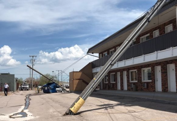 Two power poles fell over in Rapid City Wednesday.